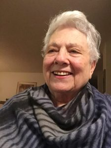 Barbara Migeon wearing her Kiss of the Wolf Shawl