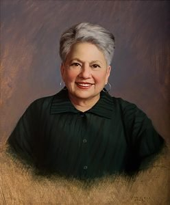 Portrait of Dr. Barbara Migeon in the Johns Hopkins Portrait Collection. She chose to wear Kiss of the Wolf. Painted by by Lisa Egeli