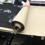 Rolling the silk up with the paper. Huari Batik Process for Bubble Silk